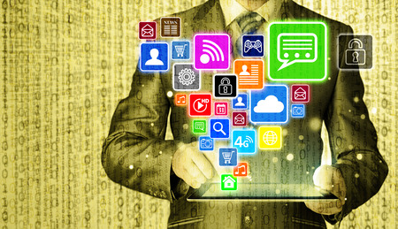 pc icon: Business man using tablet PC with social media icon set