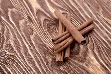 string together: Bunch of cinnamon sticks