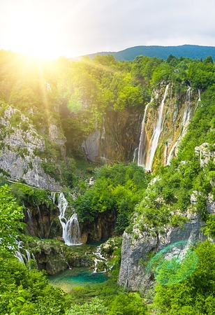 waterfall with sky: waterfall in mountain forest Stock Photo