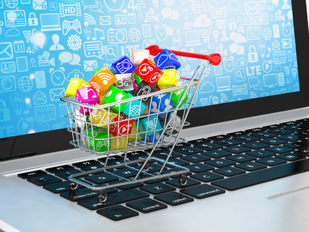 programs: shopping cart with application software icons on laptop