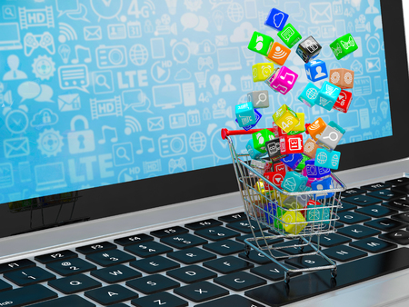 background information: shopping cart with application software icons on laptop