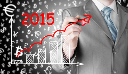year increase: business man drawing growth graph for year 2015