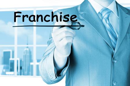man writing: business man writing franchise