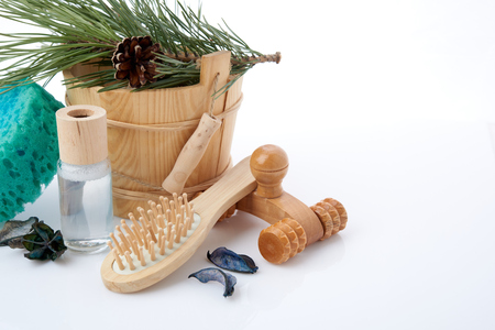 sauna: Wooden bucket with ladle for the sauna and stack of clean towels