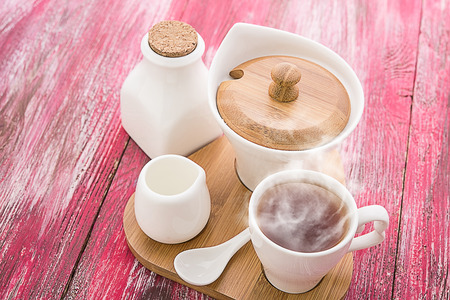 fireclay: Tea cups with teapot on old wooden table