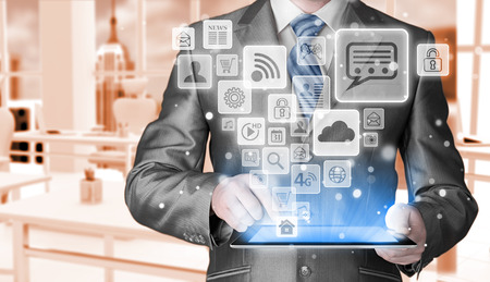 social media icon set: Business man using tablet PC with social media icon set