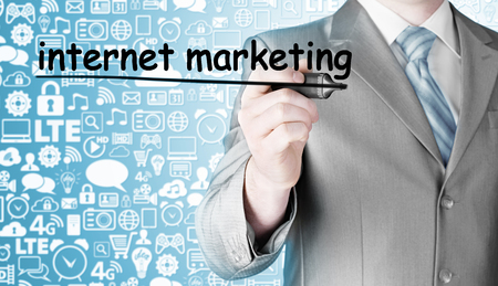 business man writing internet marketing Stock Photo