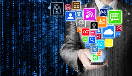 media: Business man using smart phone with social media icon set Stock Photo