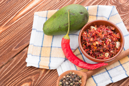 food ingredient: Chili papper on wooden Stock Photo