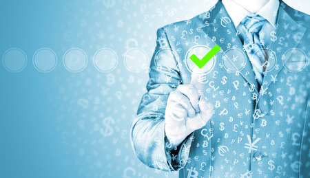 to check: business man touching, pressing modern button with green ticking Check Box. Stock Photo