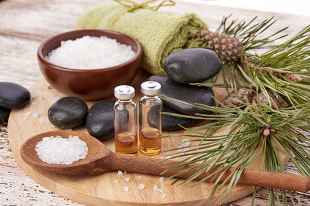 oil massage: Composition of spa treatment on wooden background