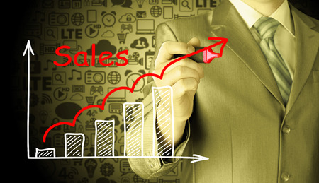 year increase: business man drawing graph of sales Stock Photo