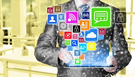 using tablet: Business man using tablet PC with social media icon set