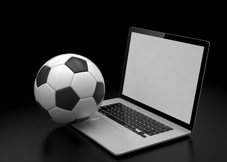 betting: laptop and soccer football ball. on line soccer betting concept. Stock Photo