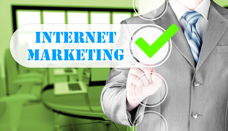 viral marketing: business man pressing checkbox  internet marketing Stock Photo