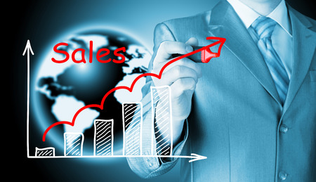 upturn: business man drawing graph of sales Stock Photo