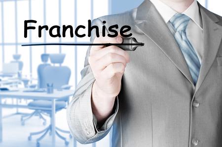franchise: business man writing franchise