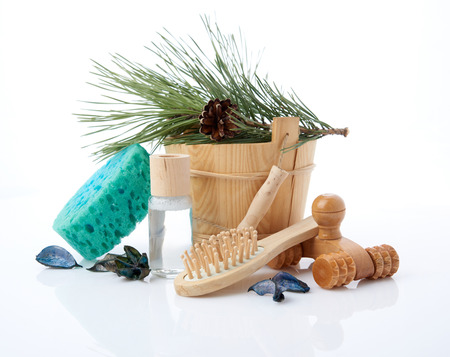 finnish bath: Wooden bucket with ladle for the sauna and stack of clean towels