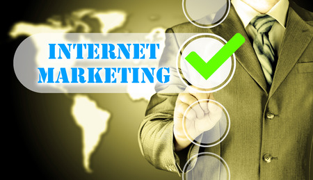 business man pressing checkbox  internet marketing Stock Photo