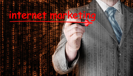 adwords: business man writing internet marketing Stock Photo