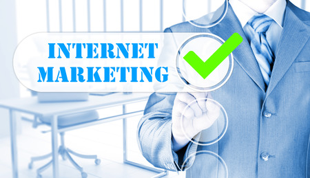 adwords: business man pressing checkbox  internet marketing Stock Photo