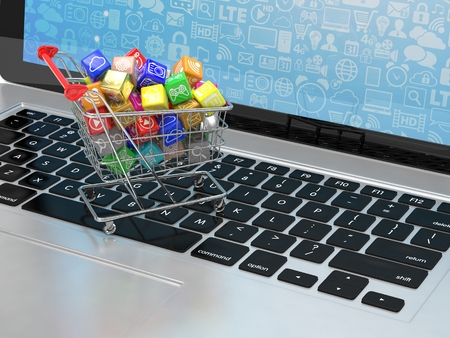 shopping cart: shopping cart with application software icons on laptop
