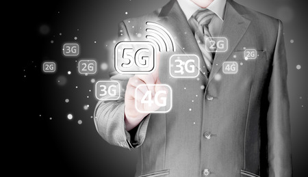 lte: Businessman choosing network connection. 2G,3G,4G,5G, LTE. Data connection. Stock Photo