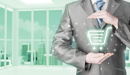 consumer: Consumer protection concept. Businessman with trolley icon. Office background.