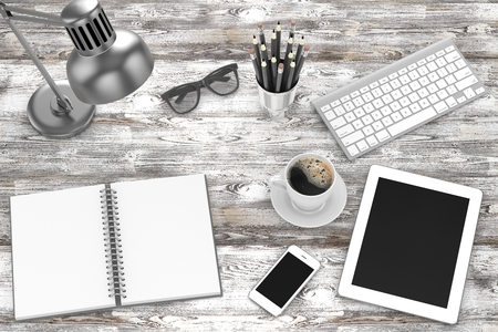 laptop mobile: Office workplace set on wooden grey table. Pc, tablet, smartphone, notebook, stationery, glasses, cup of coffee, keyboard. Stock Photo