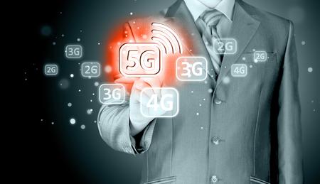 virtual world: Businessman pressing data connection. High speed data connection. New modern technologies. Virtual world.