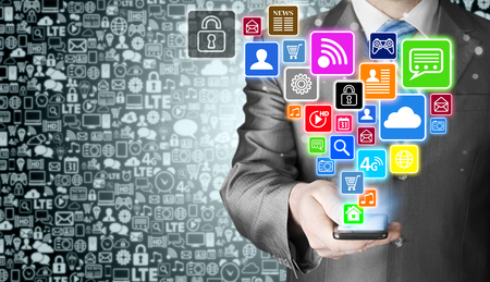 smart man: Business man using smart phone with social media icon set Stock Photo