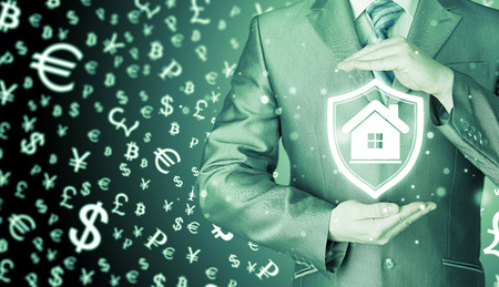real world: House protection and insurance. Home shield. Real estate safety. Money background. World currency.