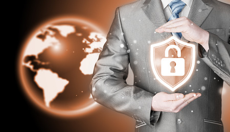 business security: Data protection and insurance. Concept of business security, safety of information from virus, crime and attack. Internet secure system. Globe background. World wide insurance.