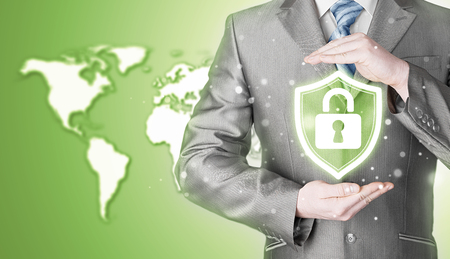 business security: Data protection and insurance. Concept of business security, safety of information from virus, crime and attack. Internet secure system. World map background. Worldwide insurance.