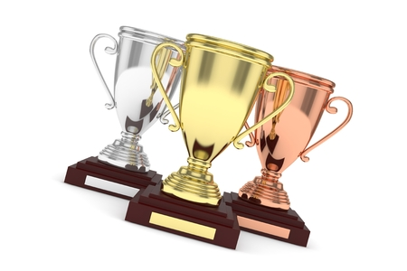 awarding: Three cups on white background. 3D rendering. Stock Photo