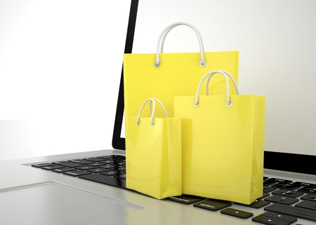paying: laptop and  shopping pags on white background. 3d rendering. Stock Photo