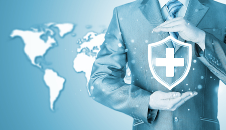 Health protection and insurance. Medical healthcare. Business in health safety. World map background. Worldwide insurance. Stock Photo