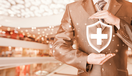 Health protection and insurance. Medical healthcare. Business in health safety. Blurred mall background. Stock Photo