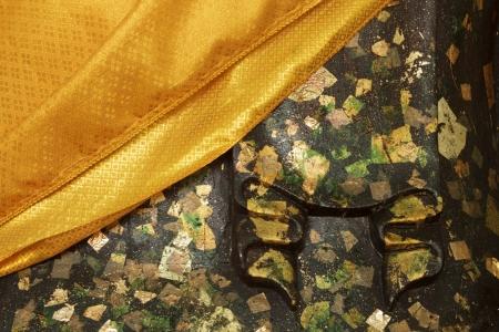 Yellow robe of budda statue