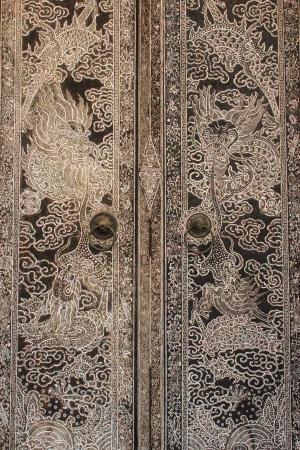 Dragon mural on temple door photo