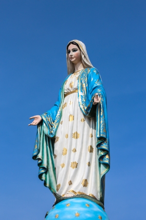 Virgin mary statue on blue sky