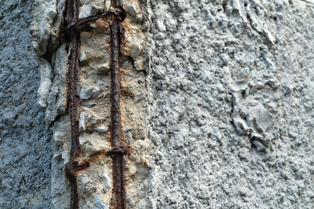 corrosion: Broken Concrete Wall and Rusty Bar Steel.