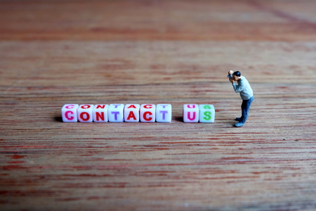 contact info: Miniature Photographer, Taking Picture of Contact Us Cubes.