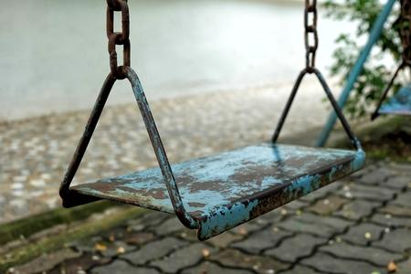 Old Metal Swing in Park. Stock Photo - 99837010