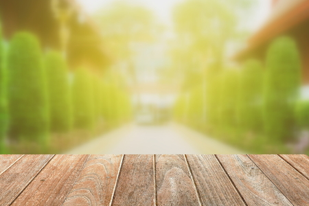Empty Wooden Board with Blurred Pathway in Garden Background. Stock Photo