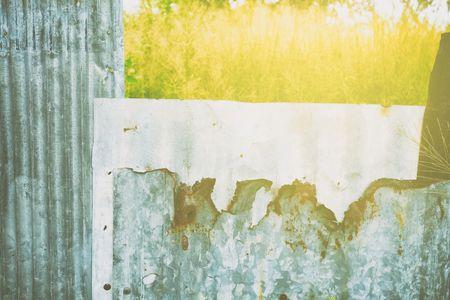 Broken Zinc Fence Background. Stock Photo