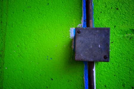 Electrical Box on Green Concrete Wall.