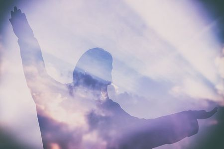 Abstract Double Exposure of Jesus Silhouette with Light Beam and Clouds.