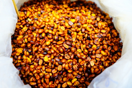 Coffee Beans in White Bag. (Selective Focus) Фото со стока
