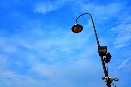 Street Lamp Pole with Blue Sky Background.